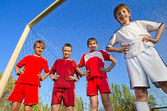 Boys stay next to goal Stock Image