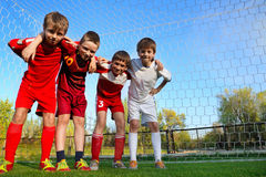 Boys stay next to goal Stock Photo