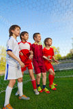 Boys stay next to goal royalty free stock images