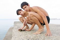 Boys and stones Royalty Free Stock Photo