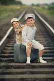 Boys with suitcase on railways Stock Image