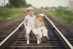 Boys with suitcase on railways Stock Photography