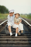 Boys with suitcase on railways Royalty Free Stock Image