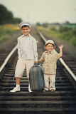 Boys with suitcase on railways Royalty Free Stock Photos