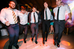 Boys in suits dance on the disco Stock Images