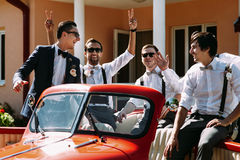 Boys in the sunglasses in the old red car Stock Photography