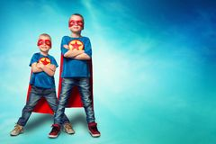 Children in superhero costumes. Boys in superhero costume guard the planet and show super abilities stock photos