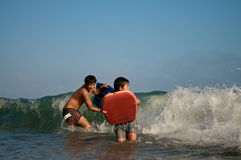 Boys surfing Stock Images