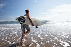 Boys surfing. At beach in sun stock image