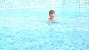 Boys swimming in the pool at the resort stock footage