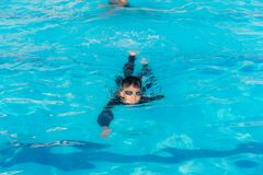 Boys are swimming in the pool royalty free stock images