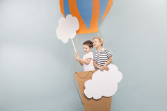 Boys taking a baloon flight Stock Photos