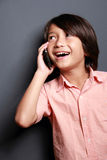 Boys talking on the phone Royalty Free Stock Photo