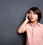 Boys talking on the phone Stock Photos
