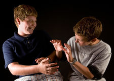 Boys teasing each other Royalty Free Stock Photos