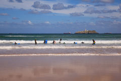 Boys teen surfing in Cantabrian sea Royalty Free Stock Image