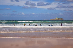 Boys teen surfing in Cantabrian sea Stock Image