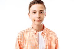 Boys teenagers, students or schoolchildren, on a white background in the Studio, go to school, preparing for the school day stock photo