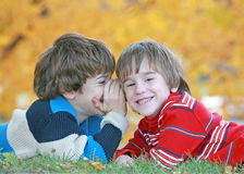 Boys Telling Secrets. Boys Laughing Whispering and Telling Secrets Stock Photography