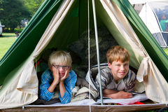 Boys in the tent. Two young boys in the tent at the camping Royalty Free Stock Image