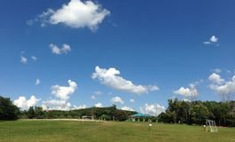 Boys in Thai student uniform play football on playground and sky in Khao Kho, Thailand royalty free stock image