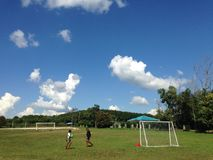 Boys in Thai student uniform playground and sky in Khao Kho, Thailand Royalty Free Stock Photography