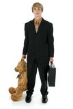 Boys to Men. Young teen business man with briefcase an large bear Royalty Free Stock Image