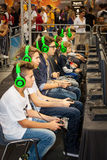 Boys tournament players and gaming consoles Royalty Free Stock Photo