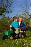 Boys and tractor. Royalty Free Stock Photography