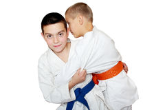 Boys trainig athletes capture for the kimono to throw Royalty Free Stock Photography