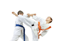 Boys are training punch arm and kick Ura-mavashi geri Stock Photography