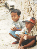 Boys try to sell conch to tourists,Indonesia Stock Photography