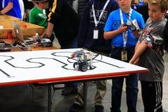 Boys tuning up their Robot at the RoboGames Stock Photos