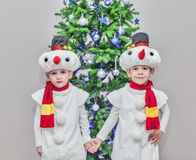 Boys, twins in carnival costumes of snowmen Stock Images