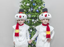 Boys, twins in carnival costumes of snowmen Stock Image