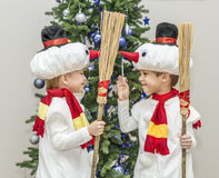 Boys, twins in carnival costumes of snowmen royalty free stock images