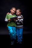 Boys using electronic tablet Royalty Free Stock Photo