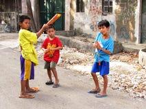 Boys using homemade plant seed guns. Cebu boys using homemade plant seed guns Royalty Free Stock Image
