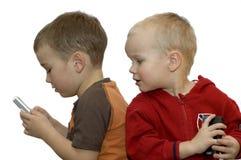 Boys using mobile Stock Photos