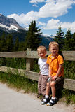 Boys on vacation. Two boys on vacation stand outdoors near Spiral Tunnel in Field, BC, Canada Stock Photos