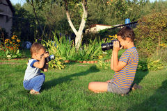 Boys with vintage photo camera Royalty Free Stock Image