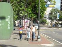 Boys walking down street in altamira caracas venezuela.  royalty free stock photo