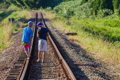 Boys Walking Railway Tracks Stock Photo