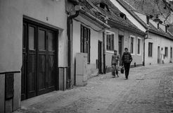 Boys walking on street in downtown Sibiu. Sibiu Hermannstadt in German was the largest and wealthiest of the seven walled citadels* built in the 12th century by royalty free stock photos