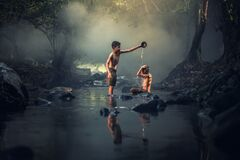 Boys washing in river