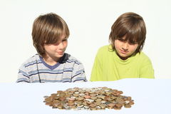 Boys watching money Royalty Free Stock Photography