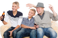 Boys watching programs on TV Stock Photos