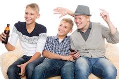 Boys watching programs on TV Stock Photos