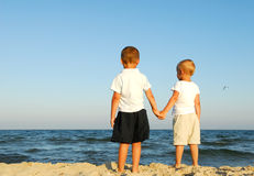 Boys watching sea Royalty Free Stock Images