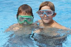 Boys in water stock image